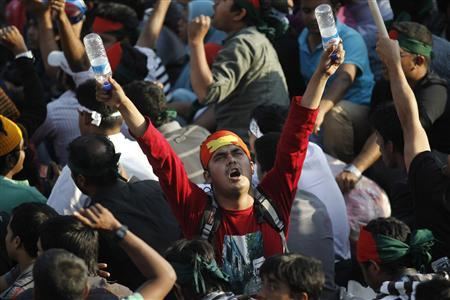 A man shouts slogans as he attends a mass demonstration at Shahbagh intersection, demanding capital punishment for Bangladesh's Jamaat-e-Islami senior leader Abdul Quader Mollah, after a war crimes tribunal sentenced him to life imprisonment, in Dhaka February 10, 2013. Thousands of protesters rallied in cities across Bangladesh for a sixth day on Sunday to demand the execution of an Islamist leader sentenced to life in prison for war crimes committed during the 1971 independence conflict. REUTERS/Andrew Biraj