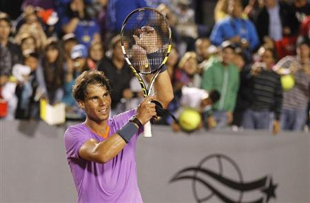 Rafael Nadal gestures after winning his men's singles match against France's Jeremy Chardy at the Chilean Open tennis tournament in Vina del Mar city February 9, 2013. REUTERS/Eliseo Fernandez