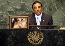Pakistan's President Asif Ali Zardari speaks next to a photograph of his late wife Benazir Bhutto as he addresses the 64th United Nations General Assembly at the U.N. headquarters in New York, September 25, 2009. REUTERS/Mike Segar