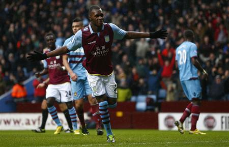 Aston Villa's Christian Benteke celebrates after scoring from the penalty spot during their English Premier League soccer match against West Ham United at Villa Park in Birmingham, central England, February 10, 2013. REUTERS/Darren Staples