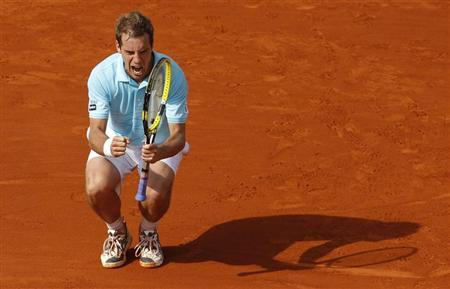 Richard Gasquet of France reacts during his match against Tommy Haas of Germany during the French Open tennis tournament at the Roland Garros stadium in Paris June 2, 2012. REUTERS/Benoit Tessier