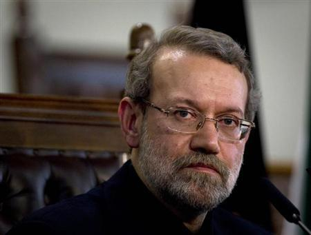 Iran's Parliament speaker Ali Larijani speaks to the media during a news conference in Tehran November 30, 2011. REUTERS/Caren Firouz/Files