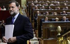 Spanish opposition leader Mariano Rajoy heads to the podium to deliver a speech during a Parliament session in Madrid September 10, 2008. REUTERS/Susana Vera