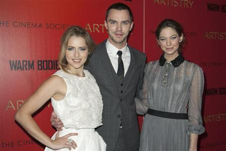 (L-R) Actress Teresa Palmer, Actor Nicholas Hoult and Actress Analeigh Tipton attend a screening of the film ''Warm Bodies'' in New York January 25, 2013. REUTERS/Andrew Kelly/Files