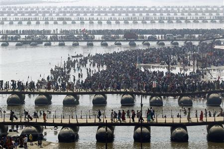 Hindu devotees cross the river Ganges on pontoon bridges after bathing in the waters at Sangam - the confluence of the Ganges, Yamuna and mythical Saraswati rivers - after the second ''Shahi Snan'' (grand bath), during the ongoing ''Kumbh Mela'' or Pitcher Festival in the northern Indian city of Allahabad February 10, 2013. REUTERS/Jitendra Prakash