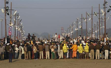 People gather to watch as sadhus take a dip during the second ''Shahi Snan'' (grand bath), of the ongoing Kumbh Mela in Allahabad February 10, 2013. REUTERS/Adnan Abidi