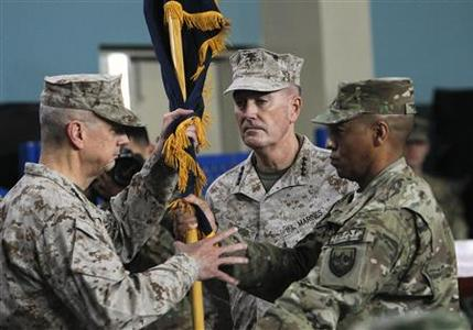 U.S. General Joseph Dunford (C), International Security Assistance Force (ISAF) commander, outgoing ISAF commander General John Allen (L) attend a change-of-command ceremony at the NATO-led ISAF headquarters in Kabul February 10, 2013. Dunford, expected to oversee the withdrawal of most foreign troops from Afghanistan by the end of next year, took control of the NATO-led mission on Sunday, in an elaborate ceremony which emphasised the country's sovereignty. REUTERS/Omar Sobhani