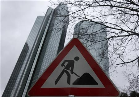 The headquarters of Germany's largest business bank, Deutsche Bank are seen behind a construction site warning sign in Frankfurt, January 30, 2013. REUTERS/Kai Pfaffenbach