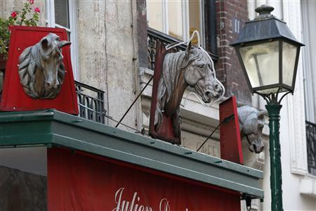 Metal horse heads are seen above a closed horsemeat butcher shop in Paris January 16, 2013. REUTERS/Charles Platiau (FRANCE - Tags: BUSINESS) - RTR3CJ43
