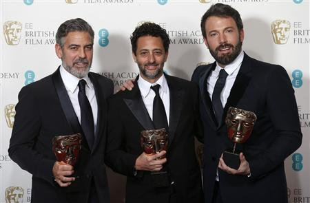 Ben Affleck (R), George Clooney (L) and Grant Heslvov celebrate after winning the Award for Best Film for the movie 'Argo' at the British Academy of Film and Arts (BAFTA) awards ceremony at the Royal Opera House in London February 10, 2013. REUTERS/Suzanne Plunkett (BRITAIN - Tags: ENTERTAINMENT) (BAFTA-WINNERS)