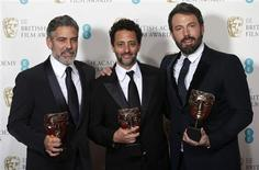 "Ben Affleck (R), George Clooney (L) and Grant Heslvov celebrate after winning the Award for Best Film for the movie ""Argo"" at the British Academy of Film and Arts (BAFTA) awards ceremony at the Royal Opera House in London February 10, 2013. REUTERS/Suzanne Plunkett (BRITAIN - Tags: ENTERTAINMENT) (BAFTA-WINNERS)"