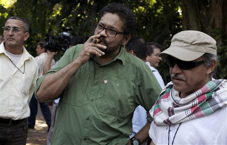 "Revolutionary Armed Forces of Colombia's (FARC) lead negotiator Ivan Marquez smokes a Cohiba cigar next to FARC negotiator Jesus Santrich (R) after a conference in Havana February 10, 2013. Colombia and the Marxist FARC rebels said on Sunday their talks aimed at ending half a century of conflict are picking up pace and making progress towards an agreement on land reform, a key point in the peace process. Speaking as they ended their latest round of negotiations in the Cuban capital, they signalled that public acrimony they had displayed in recent weeks did not represent what was happening behind closed doors. Rodrigo Granda, a senior leader of the FARC, said the discussions were moving ahead on the ""right track"" and ""at the speed of a bullet train."" REUTERS/Enrique De La Osa (CUBA - Tags: POLITICS CIVIL UNREST)"