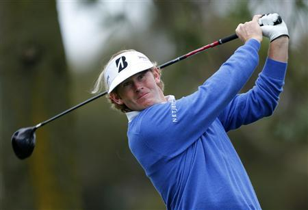 U.S. golfer Brandt Snedeker hits a drive off the 11th tee of the south course at Torrey Pines during first round play at the Farmers Insurance Open in San Diego, California January 24, 2013. REUTERS/Mike Blake (UNITED STATES - Tags: SPORT GOLF) - RTR3CWP2