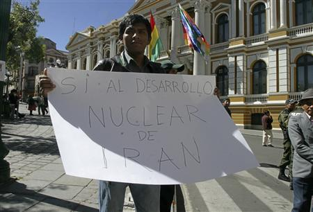 A man holds a sign that reads ''Yes to Iran's nuclear development'' during a visit by Iran's President Mahmoud Ahmadinejad in La Paz, June 19, 2012. REUTERS/Gaston Brito