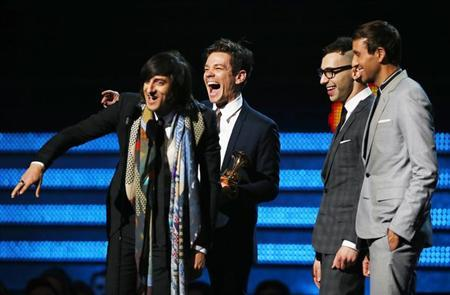 Nate Ruess (C) and Fun accept the Grammy award for song of the year for ''We Are Young'' at the 55th annual Grammy Awards in Los Angeles, California, February 10, 2013. REUTERS/Mike Blake