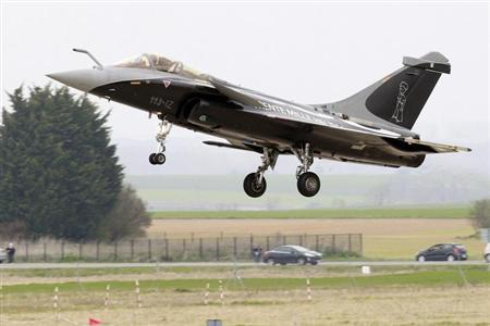 A Dassault Rafale fighter jet takes off after a flying display during ceremony of the dissolution of 1/12 squadron at BA103 air base in Cambrai-Epinoy March 30, 2012. REUTERS/Pascal Rossignol
