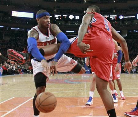 New York Knicks forward Carmelo Anthony (7) tries to pass against Los Angeles Clippers center DeAndre Jordan (6) in the first quarter of their NBA basketball game at Madison Square Garden in New York, February 10, 2013. REUTERS/Ray Stubblebine
