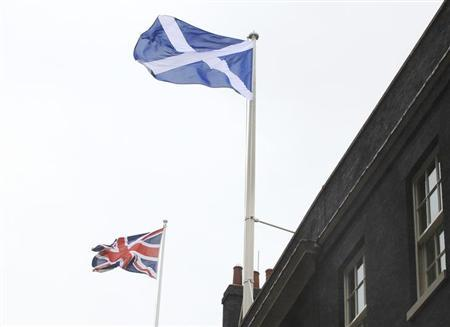 Scotland's nation flag flies alongside the Union flag (L) at Downing Street, in support of Andy Murray's men's final tennis match against Roger Federer of Switzerland, at the Wimbledon tennis championships in London July 8, 2012. REUTERS/Olivia Harris