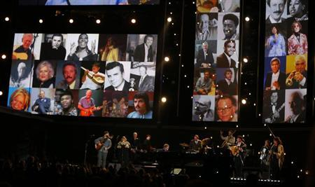 Elton John (C) and others perform ''The Weight'' as a tribute to Levon Helm of The Band, to members of the Recording Academy that passed away in 2012, and to the victims of the shootings at Sandy Hook Elementary School in Newtown, Connecticut, at the 55th annual Grammy Awards in Los Angeles, California, February 10, 2013. REUTERS/Mike Blake
