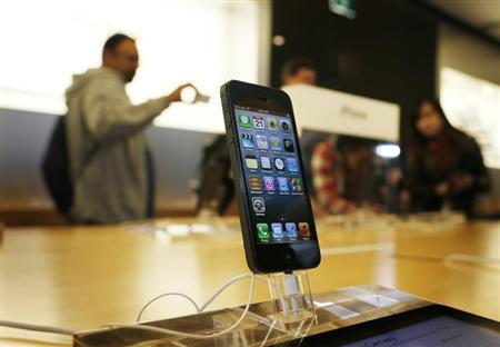 An iPhone 5 is displayed in an Apple store in central Sydney shortly after going on sale to the public September 21, 2012. REUTERS/Tim Wimborne