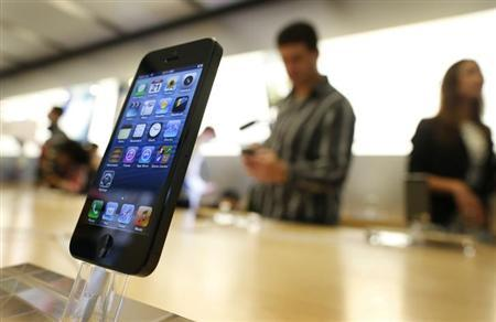 An iPhone 5 is displayed in an Apple store in central Sydney shortly after going on sale to the public September 21, 2012. REUTERS/Tim Wimborne/Files