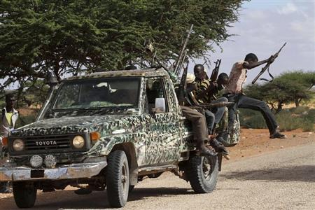 Fighters from the moderate Ahlu Sunna forces arrive at a road checkpoint outside Mareergur town, 30 km (19 miles) to the north of Dhusamareeb, in central Somalia December 17, 2012. REUTERS/Feisal Omar