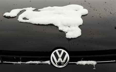 A snow-covered Volkswagen logo is pictured at a Volkswagen car dealer in the western city of Hamm January 14, 2013. REUTERS/Ina Fassbender/Files