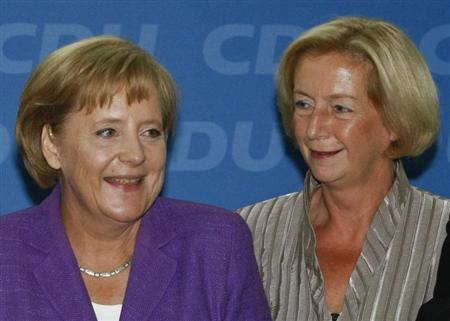 File picture shows German Chancellor and leader of the conservative Christian Democratic Union party CDU, Angela Merkel (L) as she stands with Johanna Wanka, head of the CDU in the federal state of Brandenburg, prior to a CDU party board meeting in Berlin September 28, 2009. REUTERS/Fabrizio Bensch/File (GERMANY - Tags: POLITICS)