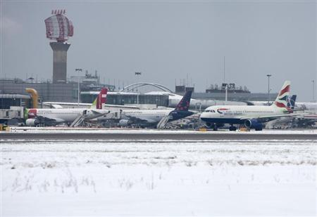 A British Airways aircraft taxis after snowfall at Heathrow airport in London January 21, 2013. REUTERS/Neil Hall