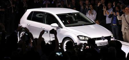 The new Volkswagen Golf model is unveiled in Berlin in this file photo taken September 4, 2012. Auto engineer Ulrich Hackenburg's fundamental rethink of vehicle platforms, the industrial Lego from which cars are designed and made, is helping power German company Volkswagen to the top of the global sales league table several years ahead of its 2018 target. It could also make VW one of the most profitable carmakers in the world. REUTERS/Fabrizio Bensch/Files