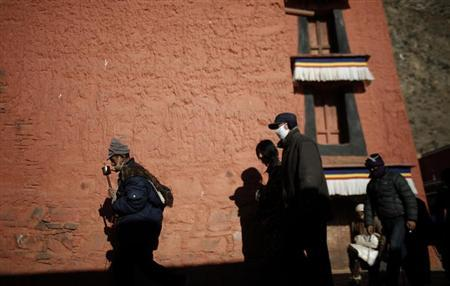Tibetans pray as they circumambulate clockwise around a temple at Labrang monastery prior Tibetan New Year in Xiahe county, Gansu Province February 21, 2012. REUTERS/Carlos Barria/Files