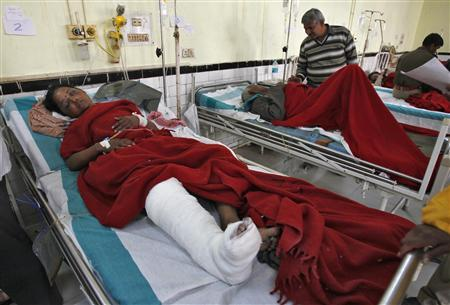 People who were injured in a stampede are treated inside a hospital in the northern Indian city of Allahabad February 11, 2013. REUTERS/Jitendra Prakash