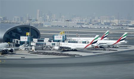 Emirates Airlines aircraft are seen at the Emirates Terminal at Dubai International Airport, February 10, 2013. REUTERS/Jumana El Heloueh