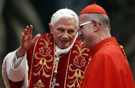 Pope Benedict XVI (L) waves during a mass conducted by Cardinal Tarcisio Bertone (R) for the 900th anniversary of the Order of the Knights of Malta, at the St. Peter Basilica in Vatican February 9, 2013. REUTERS/Alessandro Bianchi