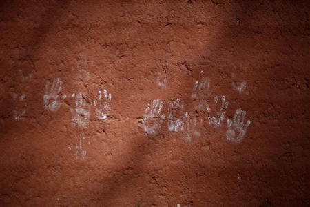 Hand prints are seen on a wall at Labrang Monastery during the Tibetan new year, in Xiahe county, Gansu Province, February 11, 2013. REUTERS/Carlos Barria