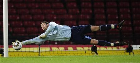 Scotland's Craig Gordon makes a save during their international friendly soccer match against Czech Republic at Hampden Park in Glasgow, Scotland, March 3, 2010. REUTERS/Russell Cheyne