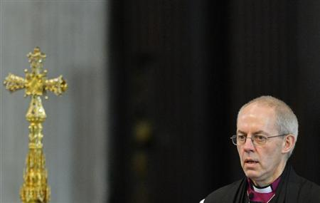 Justin Welby, the new Archbishop of Canterbury, leaves at the close of the ceremony to confirm his election as Archbishop, at St Paul's Cathedral in central London February 4, 2013. REUTERS/Toby Melville