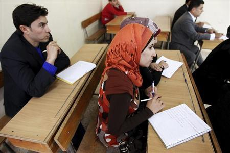 Syrian Kurds practise reading the Kurdish language at a school in Derik, Al-Hasakah October 31, 2012. REUTERS/Thaier al-Sudani