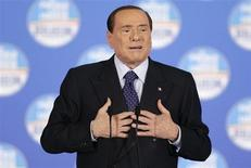 Former Italian prime minister Silvio Berlusconi speaks during a political rally in downtown Rome, February 7, 2013. REUTERS/Max Rossi