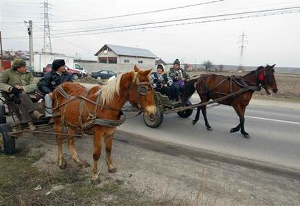 People ride in their horse-driven carts in Poroschia village, 90 km south of Bucharest on February 11, 2013. REUTERS/Bogdan Cristel