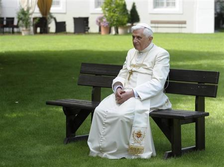 Pope Benedict XVI sits on a garden bench during his annual holiday in Bressanone, northern Italy July 31, 2008. REUTERS/Osservatore Romano