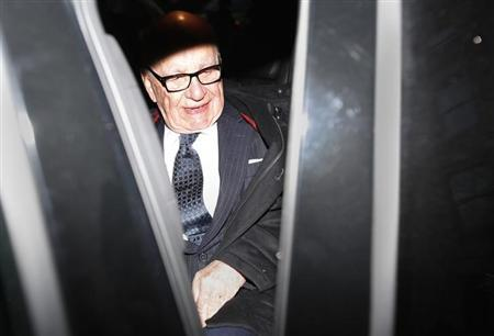 Media mogul Rupert Murdoch leaves his Fifth Avenue home in New York, November 29, 2012. REUTERS/Carlo Allegri