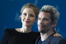 "Cast members Julie Delpy (L) and Ethan Hawke pose during a photocall to promote their movie ""Before Midnight"" at the 63rd Berlinale International Film Festival in Berlin February 11, 2013. REUTERS/Thomas Peter"