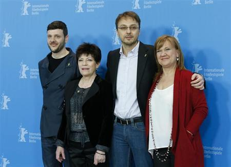 Actors Bogdan Dumitrache (L-R), Luminita Gheorghiu, director Calin Peter Netzer and producer Ada Solomon pose during a photocall to promote the movie ''Pozitia Copilului'' (Child's Pose) at the 63rd Berlinale International Film Festival in Berlin February 11, 2013. REUTERS/Tobias Schwarz