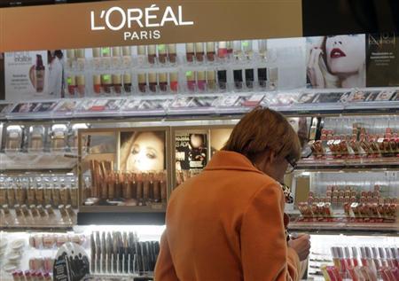 A woman looks at L'Oreal cosmetics in a shop in Riga April 13, 2012. REUTERS/Ints Kalnins