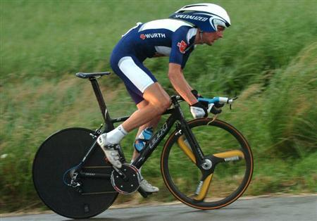 Joerg Jaksche of Germany cycles in pouring rain during the individual time-trial stage of the Tour de Suisse cycling race from Kerzers to Berne June 18, 2006. REUTERS/ARC/Jean-Bernard Sieber