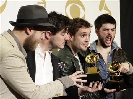 Mumford & Sons pose with their awards for Album of the Year for ''Babel'' and Best Long Form Music Video for ''Big Easy Express'' backstage at the 55th annual Grammy Awards in Los Angeles, California February 10, 2013. REUTERS/Jonathan Alcorn