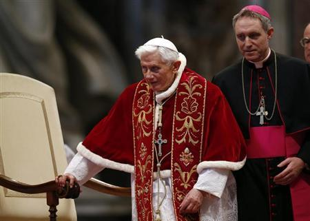 Pope Benedict XVI leaves at the end of a mass at the St. Peter Basilica in Vatican February 9, 2013. Pope Benedict will step down as head of the Catholic Church on Feb. 28, the Vatican confirmed on February 11, 2013. REUTERS/Alessandro Bianchi