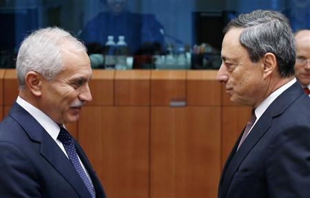 Cyprus's Finance Minister Vassos Shiarly talks to European Central Bank (ECB) President Mario Draghi (R) during an euro zone finance ministers meeting at the European Union Council in Brussels February 11, 2013. REUTERS/Francois Lenoir