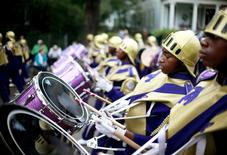 Members of the St. Augustine High School band march down St. Charles Avenue as the Krewe of Mid-City parades during the weekend before Mardi Gras in New Orleans, Louisiana February 10, 2013. REUTERS/Sean Gardner